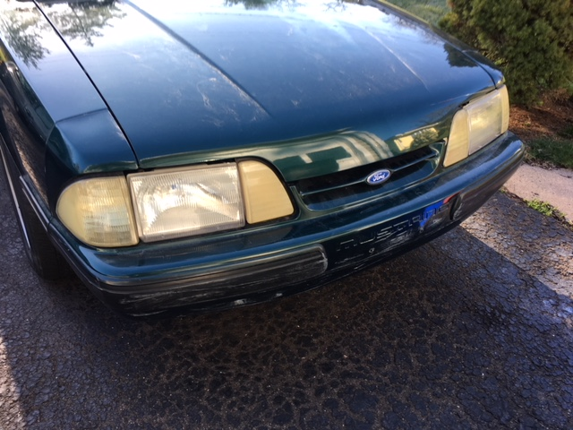 Headlights are yellowed and front bumper is scuffed.